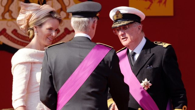 King Albert II of Belgium (R) speaks to King Philippe of Belgium (C) and Queen Mathilde (L) during the celebrations