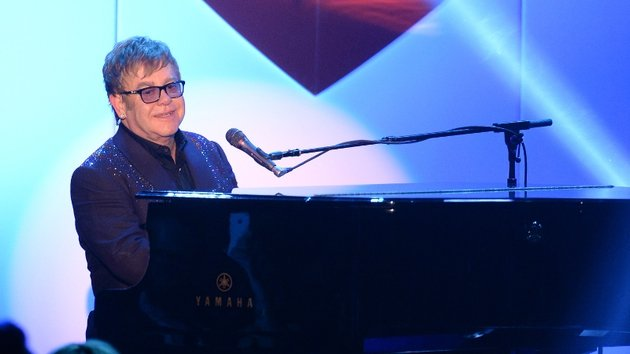 Elton claims he once jived with the Queen of England