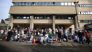 Reporters and photographers take position outside St Mary's Hospital