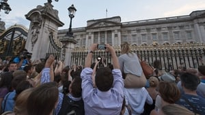 Well-wishers at Buckingham Palace strain to catch a view of the royal baby announcement