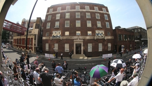 Royal watchers wait for the first glimpse of the new prince outside St Mary's Hospital