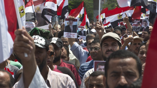 Supporters of Mohammed Mursi marching towards Cairo University yesterday