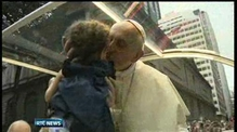 Pope Francis greeted by tens of thousands of pilgrims in Brazil