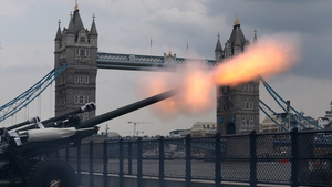 Guns fire outside the Tower of London as part of a salute to the royal baby