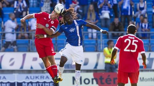 Sligo's Gavin Peers jumps with Daniel Chima Chukwu of Molde