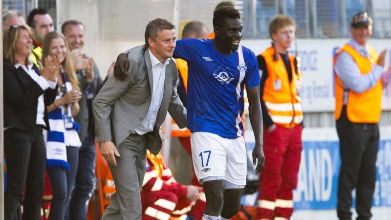 Molde's Aliou Coly celebrates his goal with manager Ole Gunnar Solskjaer