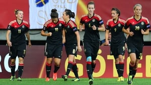 Dzsenifer Marozsan (No 10) celebrates with her team-mates after she scores her team's opening goal during the UEFA Women's Euro 2013 semi-final