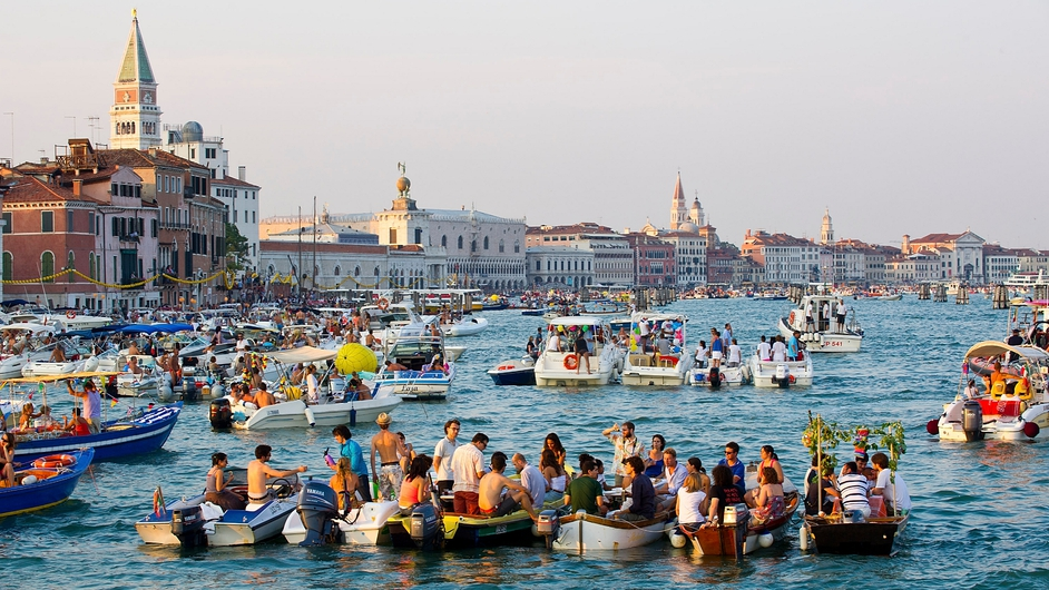 Revellers gather on boats in St Mark's Basin, Venice, as part of the Festa del Redentore