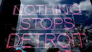 A sign appears in a Detroit shop window in the week the city became the largest to file for bankruptcy in US history