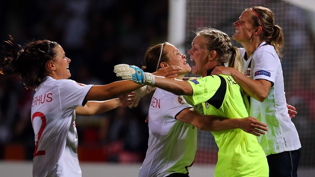 Norway goalkeeper Ingrid Hjelmseth celebrates with her team-mates after winning their UEFA Women's Championship semi-final