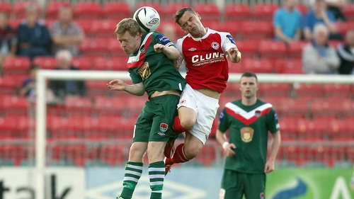 Daryl Horgan of Cork with Greg Bolger of St Pat's