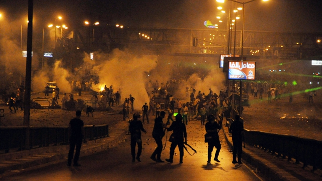 Supporters of Mohammed Mursi clash with riot police in Cairo