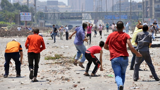 Rival factions clashed in Cairo yesterday