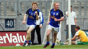 Niall McDermott (left) celebrates Cavan's goal as they secured victory over their English-based opposition