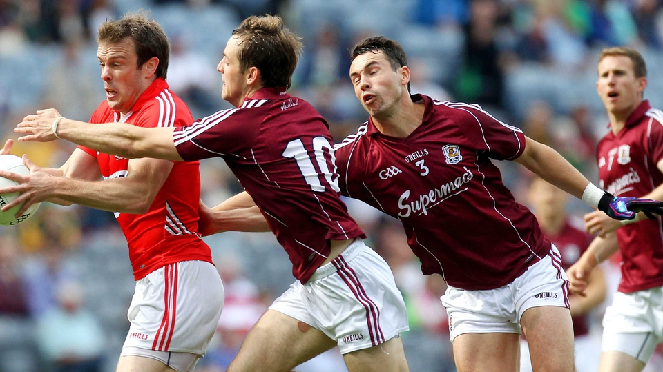 Cork's James Loughrey evades John O'Brien and Finian Hanley of Galway in their round four qualifier clash