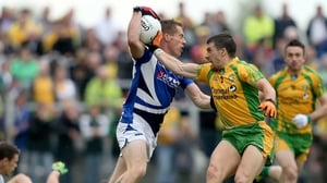 Laois' Darren Strong is marked by Paddy McGrath of Donegal