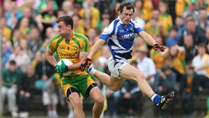 Donegal's Eamonn McGee and Padraig McMahon of Laois battle in their round four qualifier tie