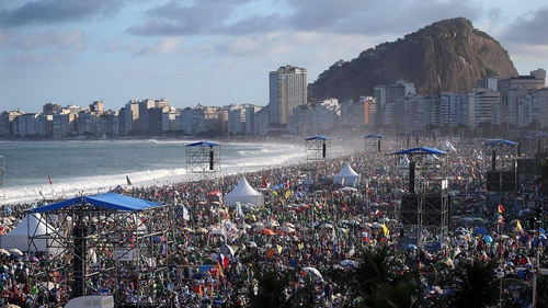 Pilgrims and others jam Copacabana beach ahead of the visit of Pope Francis