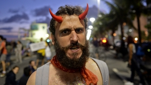 A man protests against the Catholic Church at Copacabana