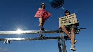 Protesters scaled a frame to help spread their message