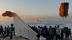 Pilgrims begin to gather after spending a night on the beach