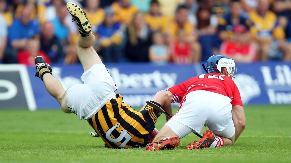 Luke O'Farrell of Cork clashes with Tommy Walsh of Kilkenny