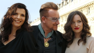 Ali Hewson, Bono and daughter Jordan pictured after the musician received the Commander of the Order of Arts and Letters in Paris recently