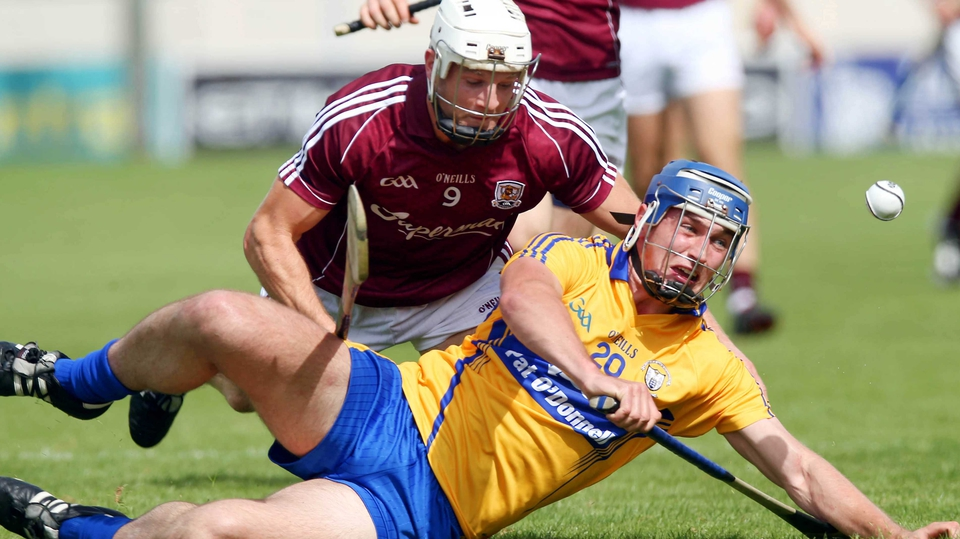 Conor Ryan of Clare and Andrew Smith of Galway fought for the sliotar on the deck