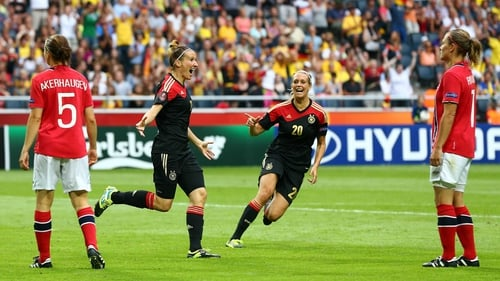 Anja Mittag (left) of Germany celebrates after she scores Germany's winning goal