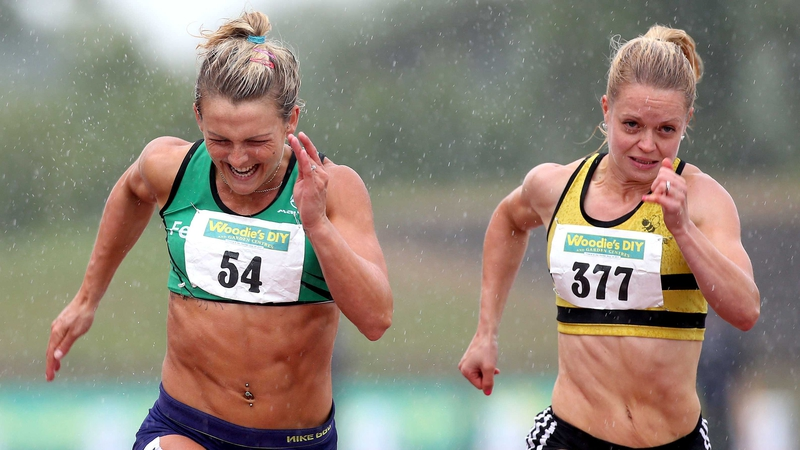 Kelly Proper (left) holds off Ailis McSweeney (right) to win the women's 100m