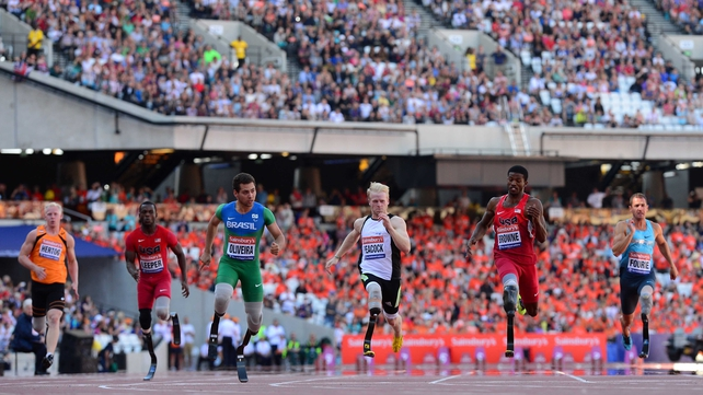 Alan Oliveira of Brazil (third from left) on his way to victory in the T43 100m