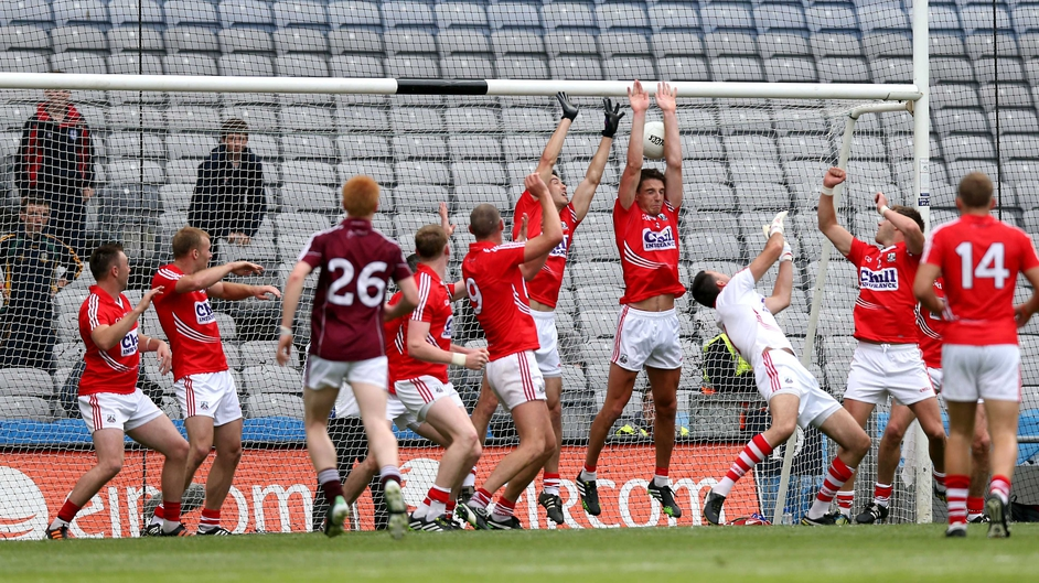 Michael Meehan scores a goal for Galway despite the best efforts of most of the Cork team