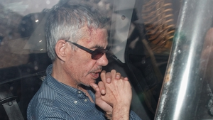 Train driver Francisco Jose Garzon Amo is taken in a police car to the preliminary court last night