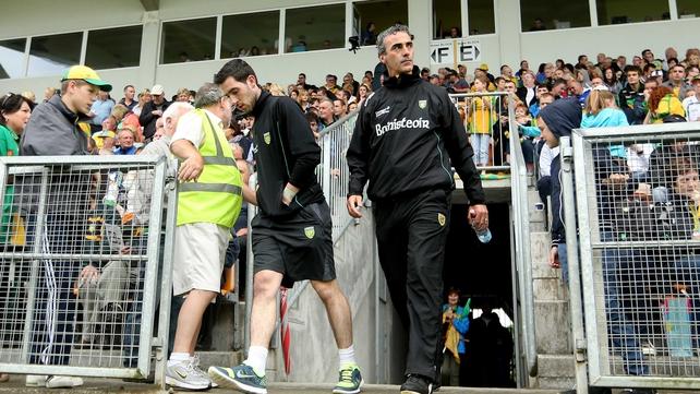 Mark McHugh and Jim McGuinness emerge from the tunnel at Páirc Seán Mac Diarmada