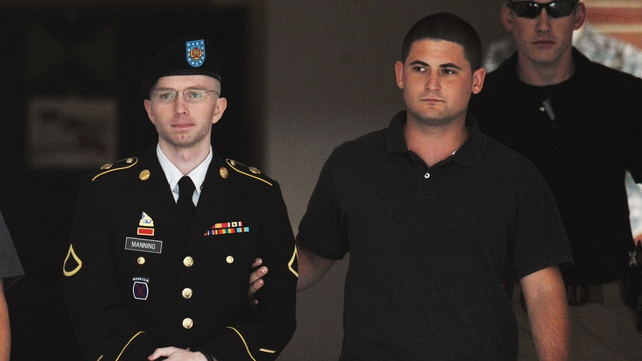 Private Manning is escorted from court during his trial