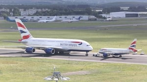 British Airways' new Airbus A380 next to the airline's smallest craft, the A318