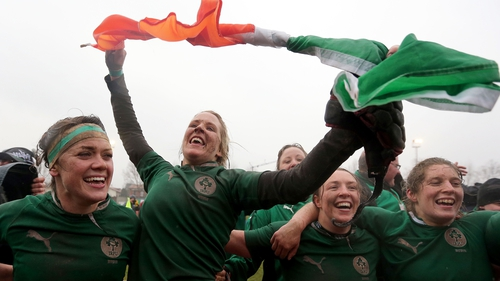 Joy Neville (second from left) celebrates with team-mates following Ireland's grand slam win