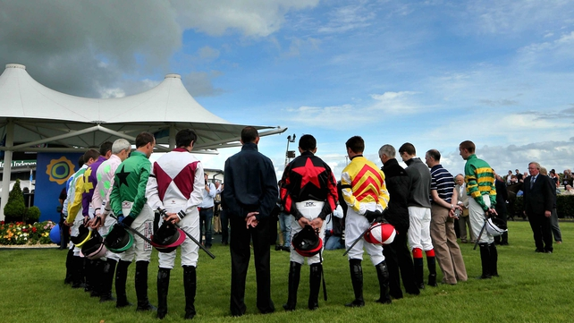 Jockey's observe a minute's silence in memory of RTE's Colm Murray ahead of the first race in Galway