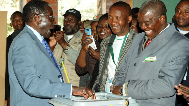 President Robert Mugabe casts his vote