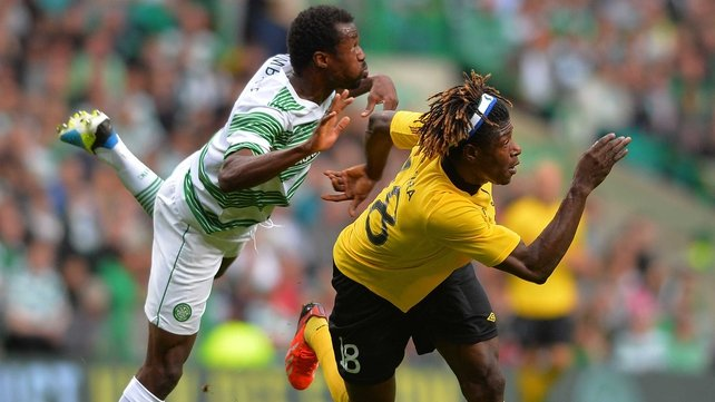 Elfsborg's Mohamed Bangura is well-marshalled by Celtic's Efe Ambrose at Celtic Park