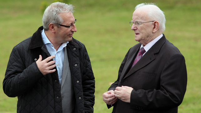 Sport journalists Tony O'Donoghue and Jimmy Magee arrive for the funeral at St Gabriel's Church