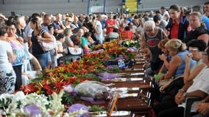 Mourners crowd around the coffins of the victims of the Italian bus crash which claimed 38 lives