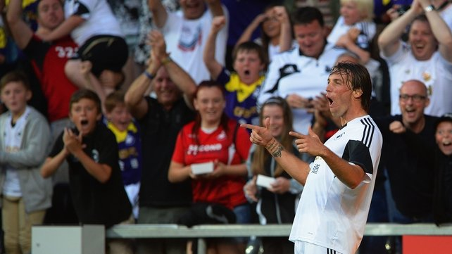 Michu celebrates during Swansea's comprehensive victory in Sweden