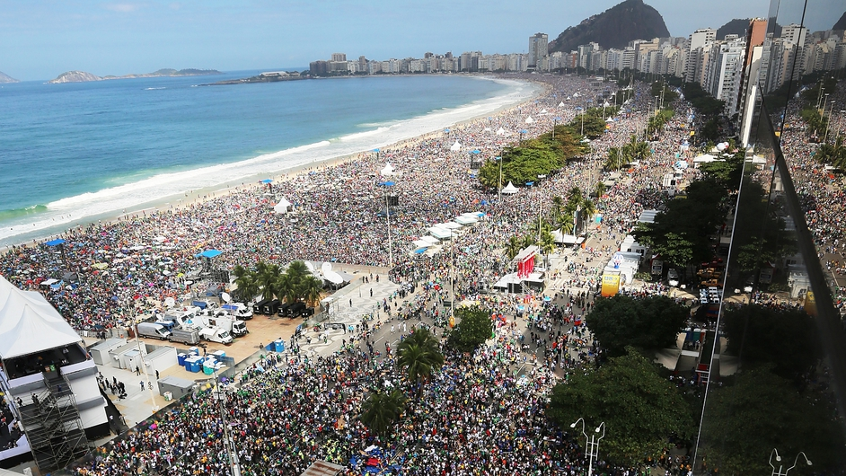 Crowds gather on Copacabana Beach during Pope Francis' final Mass in Rio de Janeiro, Brazil