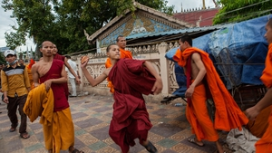 Monks clash with police during post-election protests in Cambodia