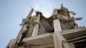 A damaged apartment block near the makeshift hospital (Pic: Robin Meldrum/MSF)