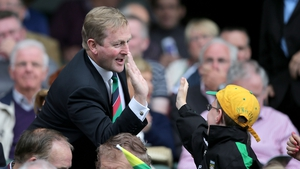Mayo man Enda Kenny high fives a young Donegal fan