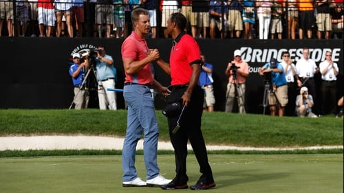 Henrik Stenson congratulates Tiger Woods on the 18th