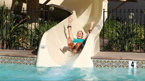 Sam Stosur goes down the ceremonial water slide after victory at La Costa Resort & Spa in California