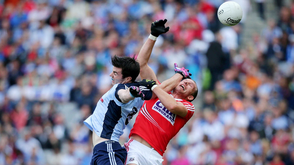 Dublin's Michael Darragh MacAuley contests a high ball with Alan O'Connor of Cork in Saturday's evening throw-in